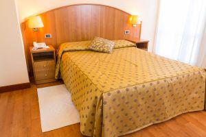 Un Letto di una camera Hotel Principe Bibione