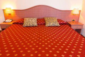 Immagine di un letto Hotel Principe, 4 stelle fronte mare a Bibione